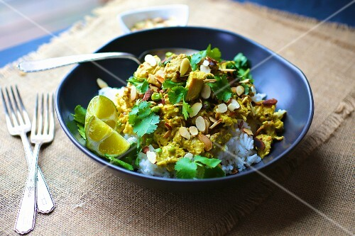 Turkey curry with almonds and coriander on a bed of rice