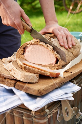 Smoked pork in a bread dough for a picnic