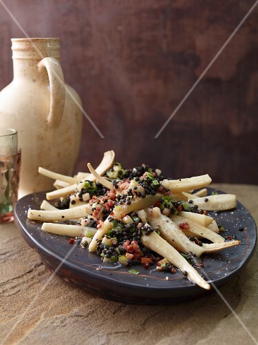 Oven-baked beluga lentil salad with parsley roots and lemons