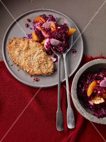 Duck escalope in Panko crumbs on red cabbage salad with nashi pears