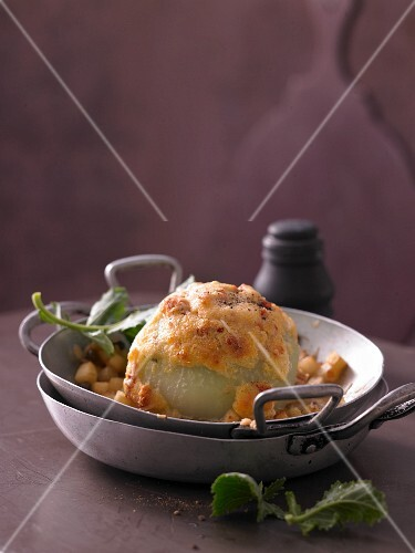 Oven baked kohlrabi filled with polenta soufflé and dried tomatoes