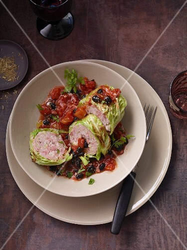 Savoy cabbage wraps with salsiccia on a black bean ragout