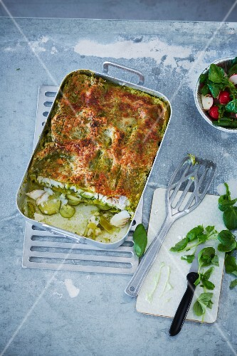 Lasagne with haddock and courgettes served with a watercress and radish salad