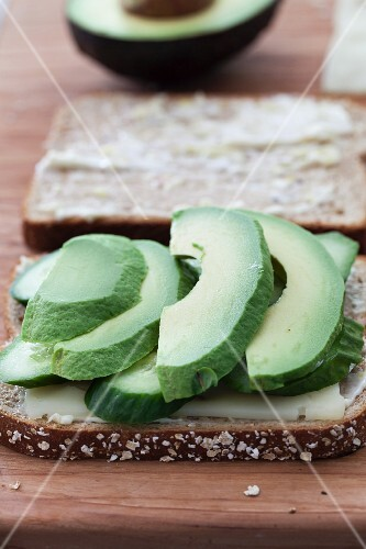 A summer sandwich with avocado, cucumber and cheese