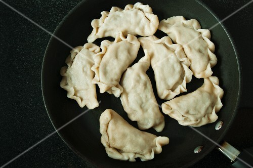 Cooked pierogi (meat-filled pastry dumpling, Poland) in a frying pan