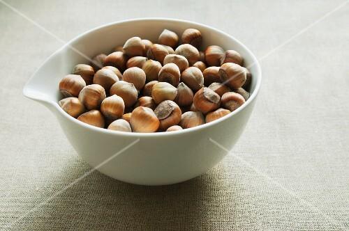 Hazelnuts in a porcelain bowl