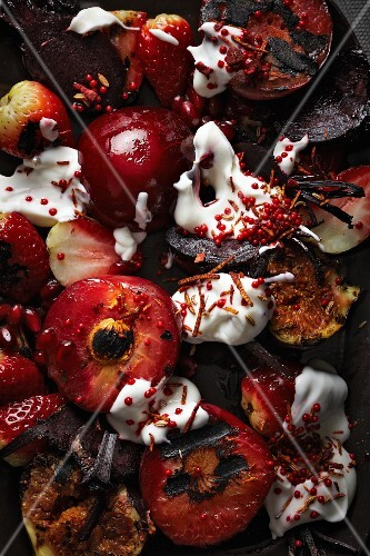 Fruit salad with plums, strawberries, figs and beetroot (seen from above)