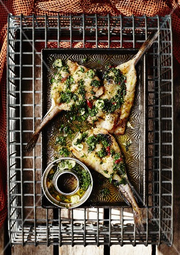 Fish with garlic, chilli and salsa verde (seen from above)