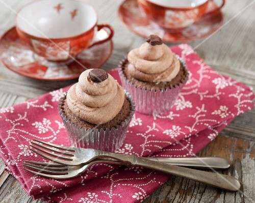 Cafe latte cupcakes on a fabric napkin