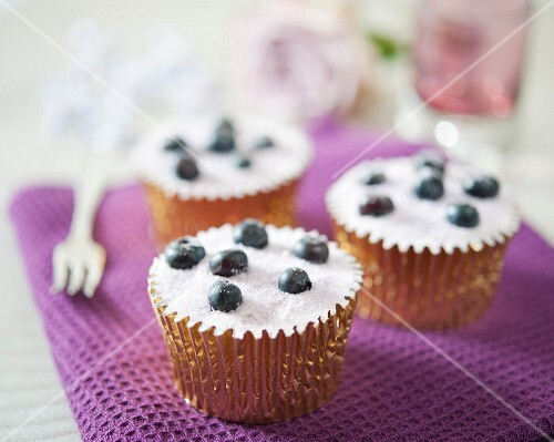Cupcakes with sugared blueberries