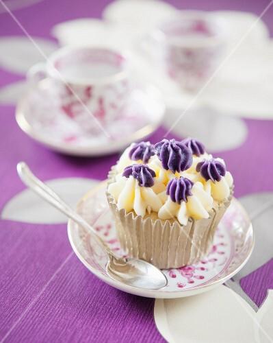 Vanilla cupcake with violet cream