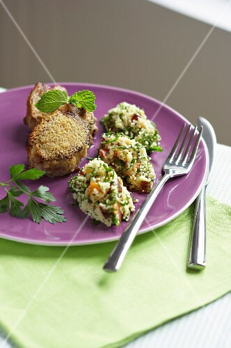 Lamb with nutmeg served with couscous with dried fruits