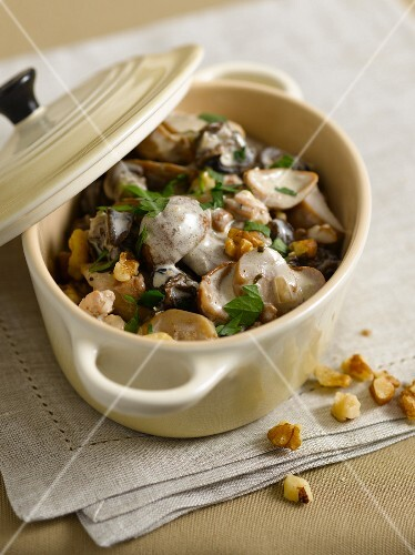 Fricassee with snails, mushrooms and nuts