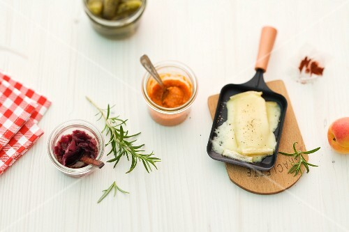 Raclette with sauces and gherkins