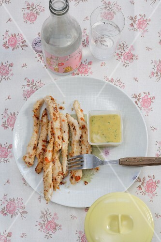 Chicken strips with a mustard and honey dip