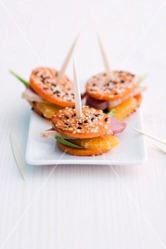 Pumpkin and mandarin skewers with duck breast