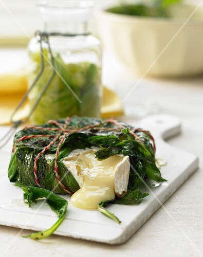 Camembert wrapped in wild herbs with Grappa grapes