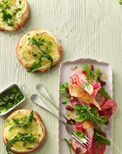 Mini potato pizzas with roasted dandelion pesto and striped beetroot salad with nashi pears