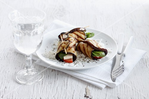 Grilled aubergine roles with tomatoes, mozzarella and basil