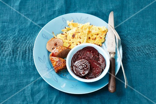Sausage with potato cakes and beetroot salad
