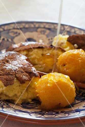 Baked Portuguese milk pudding with candied plums and honey