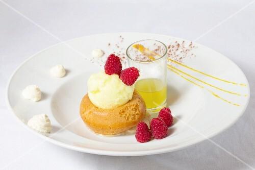 Baba al rhum with vanilla ice cream and raspberries
