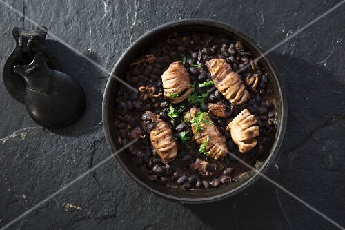 Calamari on black beans (seen from above)
