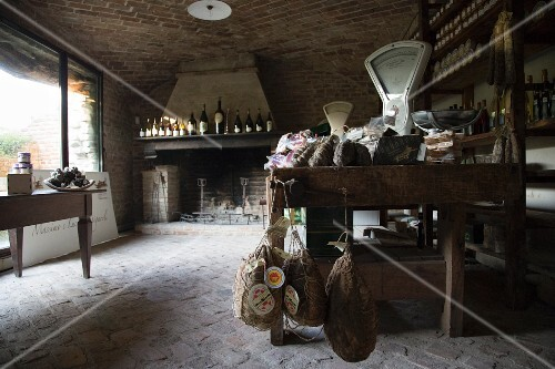 Wine and meats in a rustic, country delicatessen