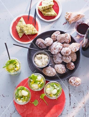 Potatoes with a salt crust, asparagus tortilla and melon salad (Spain)