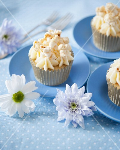 Caramel popcorn cupcakes decorated with flowers