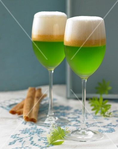 Glasses of woodruff jelly with melon soup and cremant