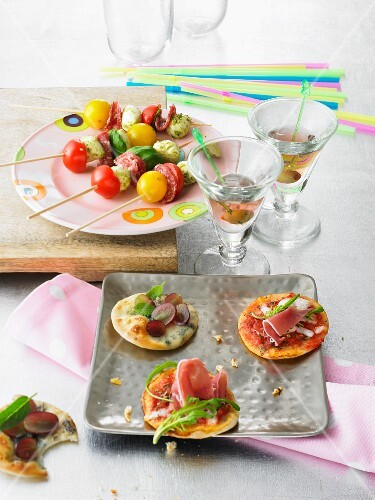 Mozzarella skewers and mini pizzas for a party buffet