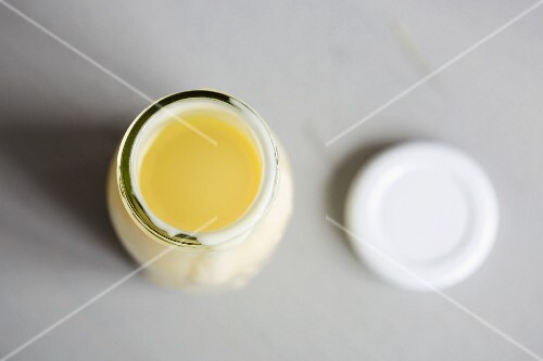 A bottle of vanilla sauce with a lid