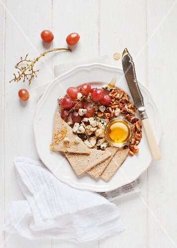 Stilton with red grapes, oat cakes, nuts and honey