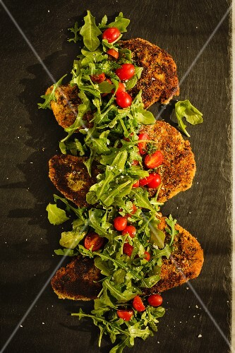 Almond-coated turkey chops with a rocket and tomato salad