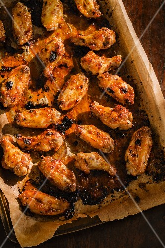 Crispy chicken wings on a baking tray