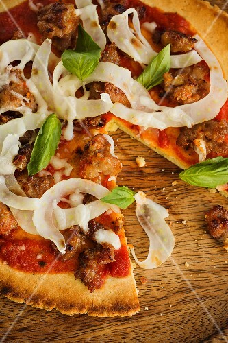 Pizza with Italian sausage, fennel and basil