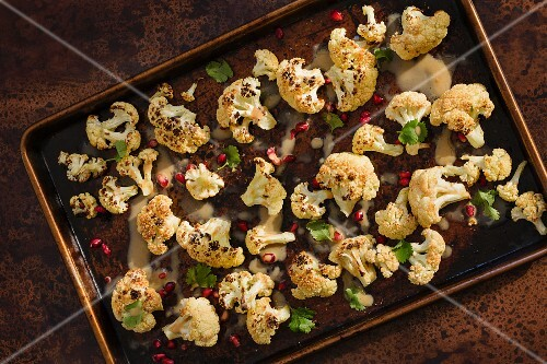 Oven-baked cauliflower with pineapple seeds and tahini