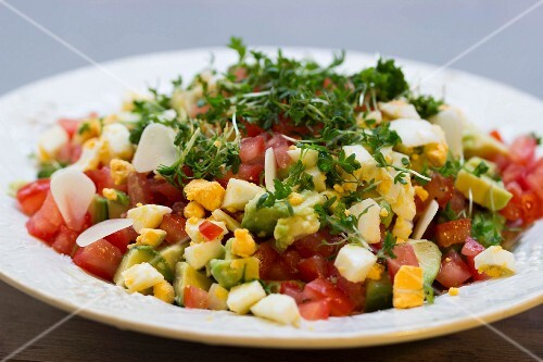 Avocado salad with eggs, tomatoes, cress and onions