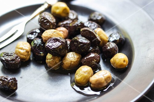 Black and green olives in olive oil