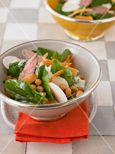 Fresh spinach salad with lamb fillet