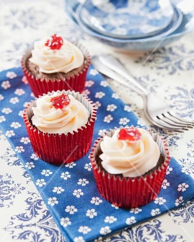 Chocolate and strawberry jam surprise cupcakes