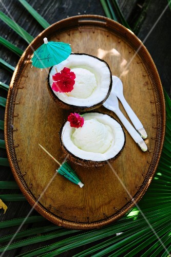 Pina colada ice cream served in a halved coconut