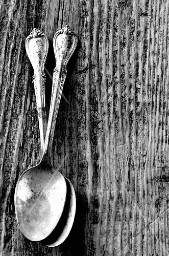 Two antique silver spoons (black-and-white shot)