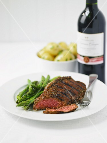 Grilled steak with green asparagus and new potatoes