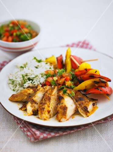 Peri-peri chicken with a pepper skewer and rice