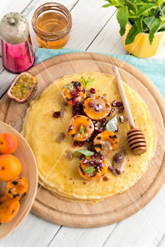 Chickpea crêpes with grilled apricots, honey and tahini