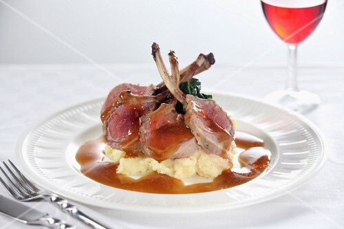 Lamb chops on mashed potatoes with gravy