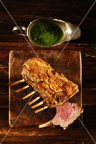 Rack of lamb with a breadcrumb crust and herb sauce