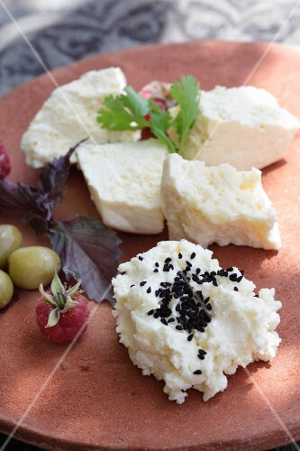 Cream cheese with black sesame seeds, feta cheese, olives and raspberries
